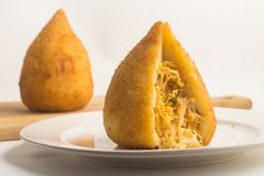 Brazilian Chicken Coxinha. Over a white background Stock Photo