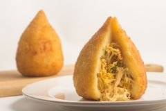 Brazilian Chicken Coxinha. Over a white background Royalty Free Stock Images