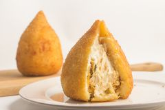 Brazilian Chicken Coxinha. Over a white background Stock Photos