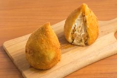 Brazilian Chicken Coxinha. Over a wooden table Royalty Free Stock Images