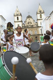 Brazilian Children Drumming Pelourinho Salvador Bahia. SALVADOR, BRAZIL - OCTOBER 15, 2013: Group of young Brazilians stand drumming in a group in the historical Royalty Free Stock Images
