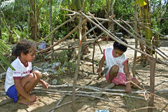 Brazilian children playfully learn to build a hut Stock Photography
