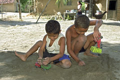 Brazilian children playing with toy trucks. Brazil, Bahia, Entre Rios. In the rural village Capim-Acie, municipality of Conde, are boys, boys, playing in the royalty free stock image