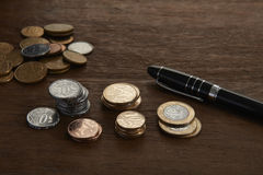 Brazilian coins. And pen on table Royalty Free Stock Image