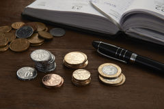 Brazilian coins. And schedule on table Stock Photos