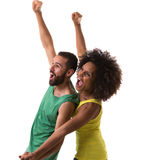 Brazilian couple celebrating for a game on white background Royalty Free Stock Images