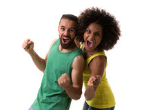 Brazilian couple celebrating for a game on white background.  Royalty Free Stock Photo