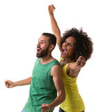 Brazilian couple celebrating for a game on white background.  Royalty Free Stock Photography
