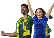 Brazilian couple Celebrating on a white background . stock photo