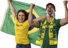 Brazilian couple Celebrating on a white background . royalty free stock photography