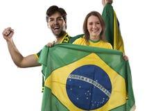 Brazilian couple Celebrating on a white background . royalty free stock images