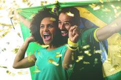 Brazilian couple fan celebrating on white.  Stock Images