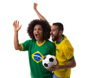 Brazilian couple of fans celebrate on white background Royalty Free Stock Photos