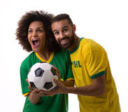 Brazilian couple of fans celebrate on white background Royalty Free Stock Image
