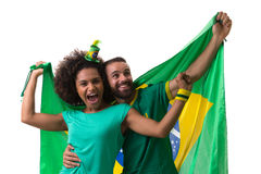 Brazilian couple of fans celebrate on white background Royalty Free Stock Photography