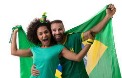 Brazilian couple of fans celebrate on white background Stock Photos