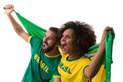 Brazilian couple of fans celebrate on white background Royalty Free Stock Images