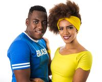 Brazilian couple fans celebrating on soccer match on white background. Brazil colors. stock photos