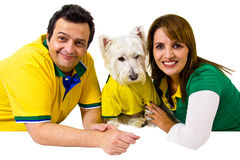 Brazilian couple and pet supporters royalty free stock images