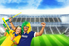 Brazilian couple supporters at stadium Stock Photography