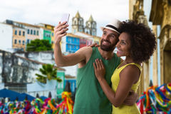 Brazilian couple taking a selfie photo in Bahia, Brazil Stock Photo