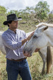 Brazilian cowboy with mare Royalty Free Stock Photography