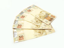 Brazilian currency. New brazilian currency over white royalty free stock image