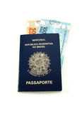 Brazilian currency and passport. New currency from Brazil inside passport royalty free stock photos