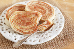 Brazilian dessert Bolo de rolo (swiss roll, roll cake) on white Royalty Free Stock Photography