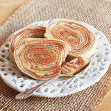 Brazilian dessert Bolo de rolo (swiss roll, roll cake) on white Stock Photo