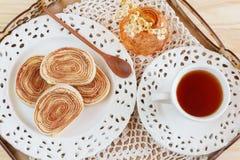 Brazilian dessert Bolo de rolo (swiss roll, rollcake) on tray Royalty Free Stock Images