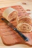 Brazilian dessert bolo de rolo (swiss roll, rollcake)  on wooden Royalty Free Stock Image