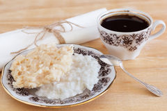 Brazilian dessert Coconut candy cocada on plate with cup of coff Stock Images