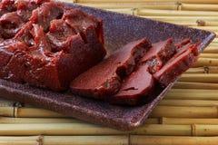 Brazilian dessert goiabada in brown plate Stock Images