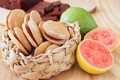 Brazilian dessert goiabada and cookies. Of goiabada with fresh goiaba on wooden table. Selective focus Royalty Free Stock Photo