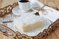 Brazilian dessert sweet couscous pudding coconut, cup of coffee Royalty Free Stock Images