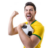 Brazilian fan celebrates on white background Royalty Free Stock Photos
