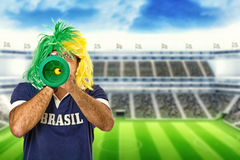 Brazilian fan celebrating a goal Royalty Free Stock Photo