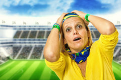 Brazilian fan desperate in a statium Stock Photos
