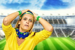 Brazilian fan desperate in a statium Stock Photo