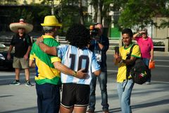 Brazilian fan next to a man dressed like Maradona Stock Photography