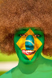 Brazilian fan. Portrait of a happy brazilian girl with a painted flag Stock Photography
