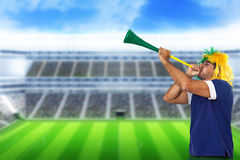 Brazilian fan at stadium playing vuvuzela Royalty Free Stock Images
