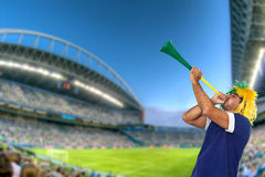 Brazilian fan at stadium playing vuvuzela Stock Images