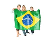 Brazilian Fans. Three girls holding Brazilian flag Stock Photos