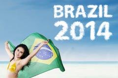 Brazilian fans holding Brazilian flag Royalty Free Stock Image