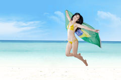 Brazilian fans jumping at beach Stock Images