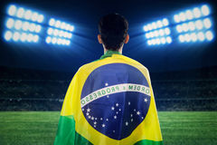 Brazilian fans looking at soccer field Stock Image