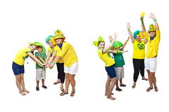 Brazilian fans stacking hands Royalty Free Stock Image