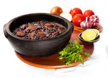 Brazilian Feijoada. Brazilian famous food Feijoada on a white background stock image